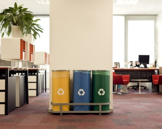 Recycling receptacles in an office.