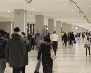 people walking down the empire state plaza concourse
