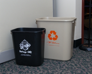 Desk-side recycling and trash bins.