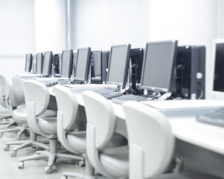 Row of white computers.