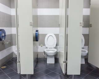 Office restroom with toilet stalls.