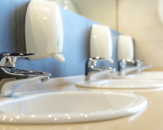 Bathroom sinks with handsoap dispensers.