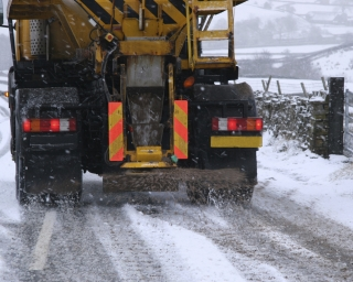 Truck spreading salt on a slippery road.