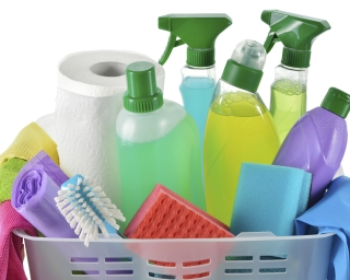 Basket of cleaning spray bottles.