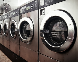 A row of commercial washing machines.