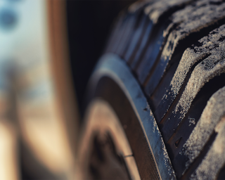 Closeup of a tire on a car.