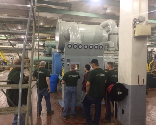 Plant Utilities Engineering employees working with a chiller at the Empire State Plaza