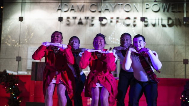 Young performers on stage at the Harlem State Office Building.