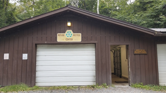 A picture of a garage at a camping ground where waste is stored.